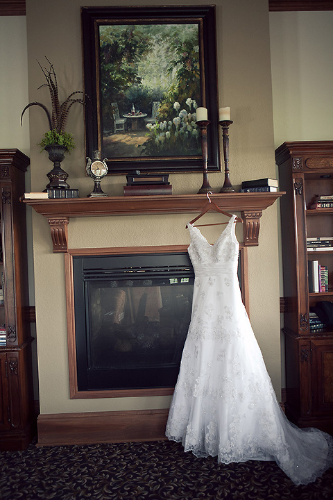 Wedding Dress hanging on mantle at Grand Highlands in Hendersonville, NC